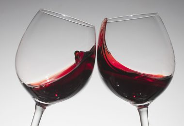 Toasting with two glasses of red wine --- Image by © Dual Dual/fstop/Corbis